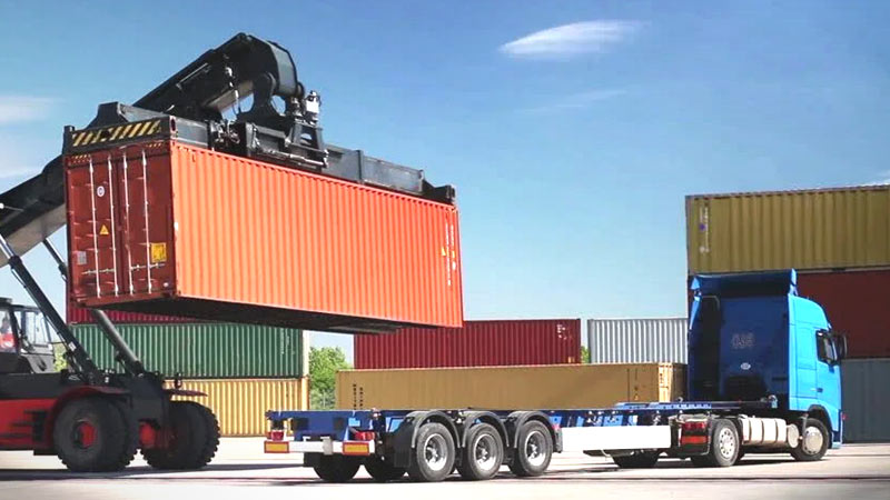 how to load a shipping container on a trailer